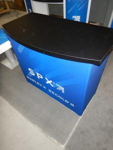 RENTAL: (1) RE-1558 Gravitee Reception Counter with SEG Fabric Wrap