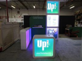 Custom Wood Fabrication Inline with Backlit Direct Print Graphics and Reception Counter