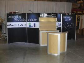 Customized ECO-2003 RENTAL with Fabric Graphics, LED Lights, Curved Header, Added Shelves, and ECO-3C Podium -- Image 1