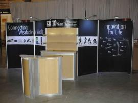 Customized ECO-2003 RENTAL with Fabric Graphics, LED Lights, Curved Header, Added Shelves, and ECO-3C Podium -- Image 2