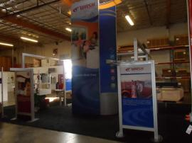 VK-5077 Island Exhibit with Custom Counters, Tension Fabric Graphics, and Wave Canopy -- Image 2