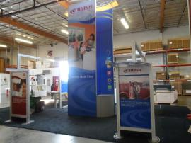 VK-5077 Island Exhibit with Custom Counters, Tension Fabric Graphics, and Wave Canopy -- Image 1