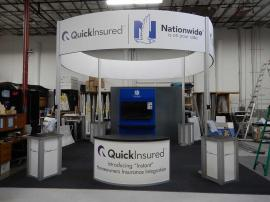 "RENTAL: Island Design with (4) Curved Headers and Double-Sided Kiosk with (2) 55"" Monitors"